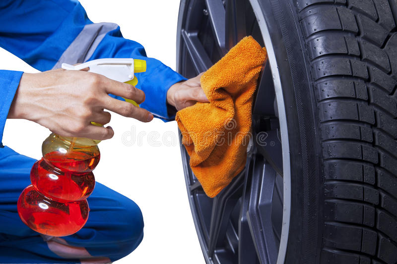 Mechanic cleaning a tire rim royalty free stock photos