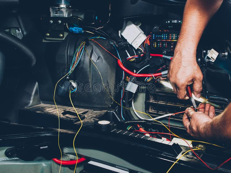 Auto service electrician wiring car maintenance stock images