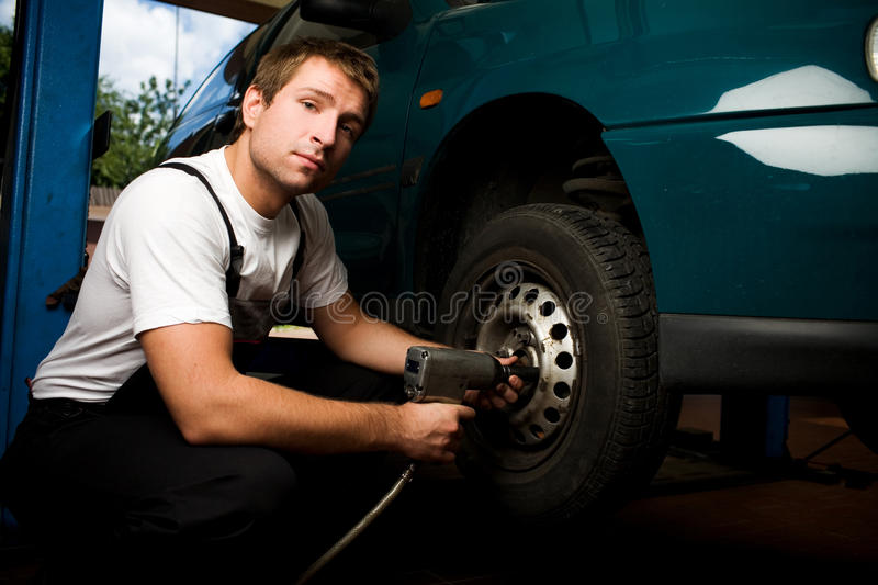 Mechanic fixing auto in car service stock images