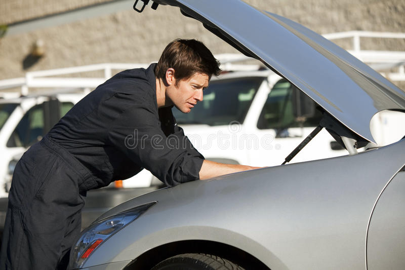 Download Mechanic fixing car stock image. Image of adult, occupation - 22140347