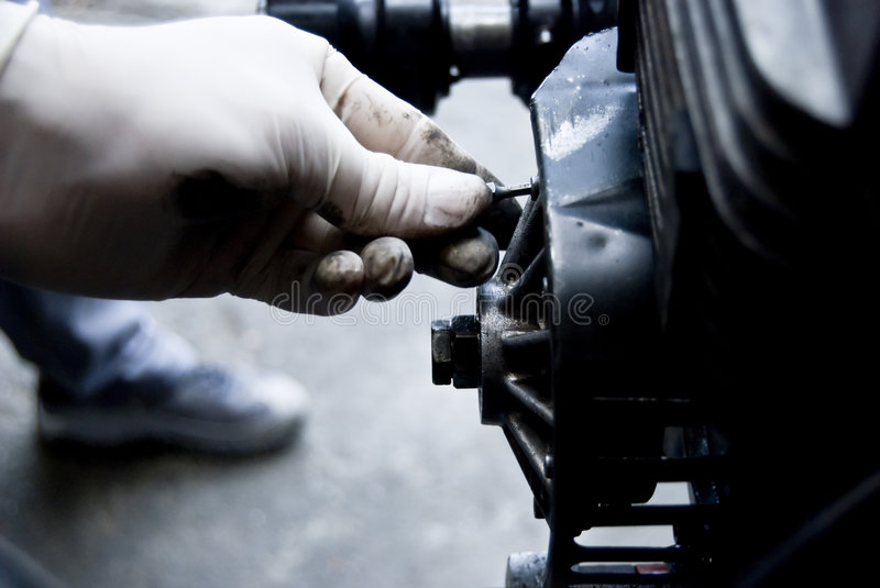 Mechanic fixing an engine royalty free stock photos
