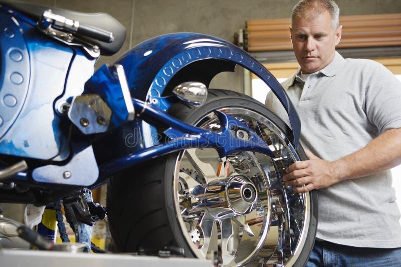 Mechanic Fixing Motorcycle stock photo