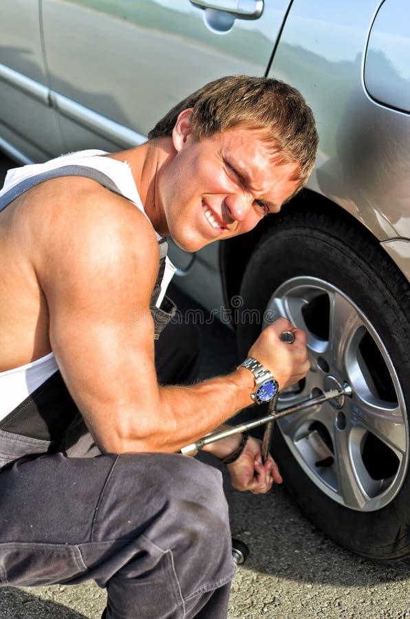 Mechanic Fixing A Tire Stock Photo