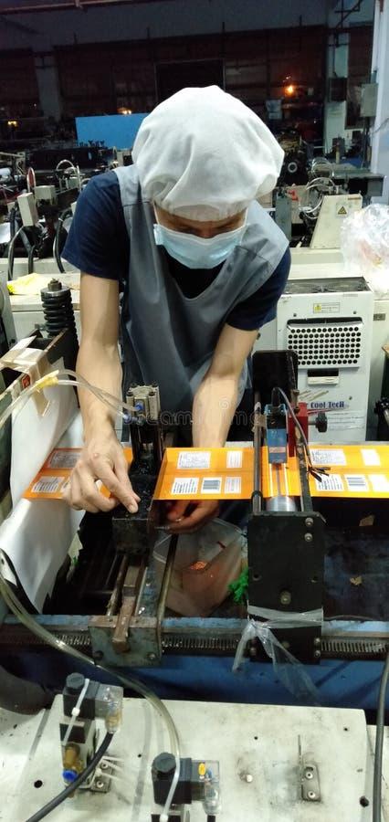 Mechanic of food envelope sealer royalty free stock images