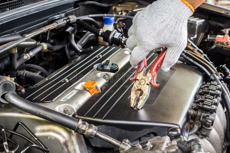 Mechanic hand holding wrench fixing car engine royalty free stock images