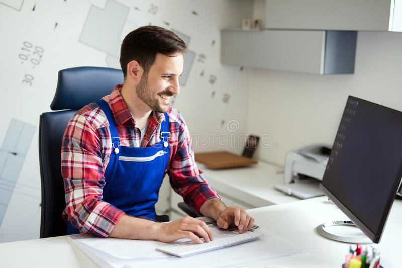Mechanic at His Workplace doing His Daily Work Auto Repair Service. In office stock images