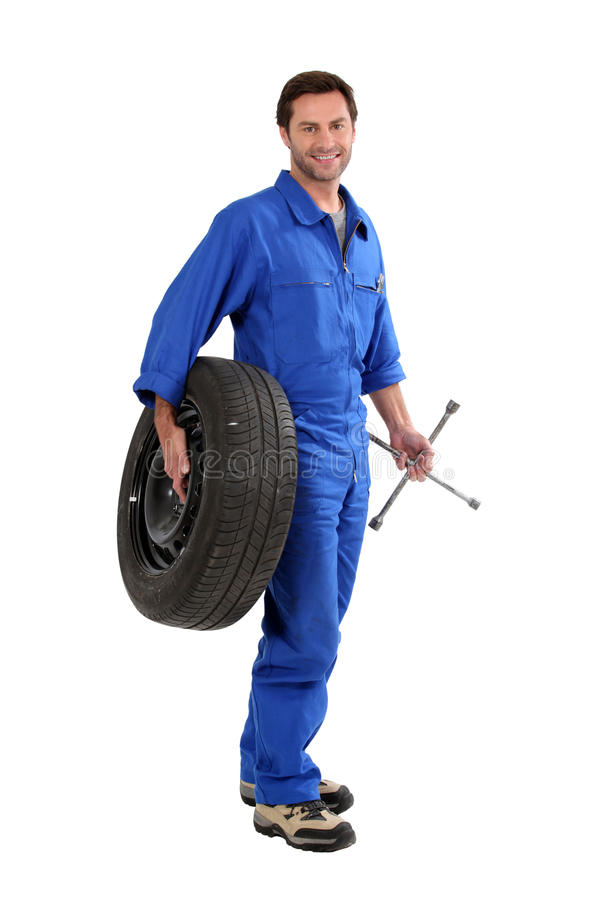Download Mechanic holding a tire stock image. Image of overalls - 22630221