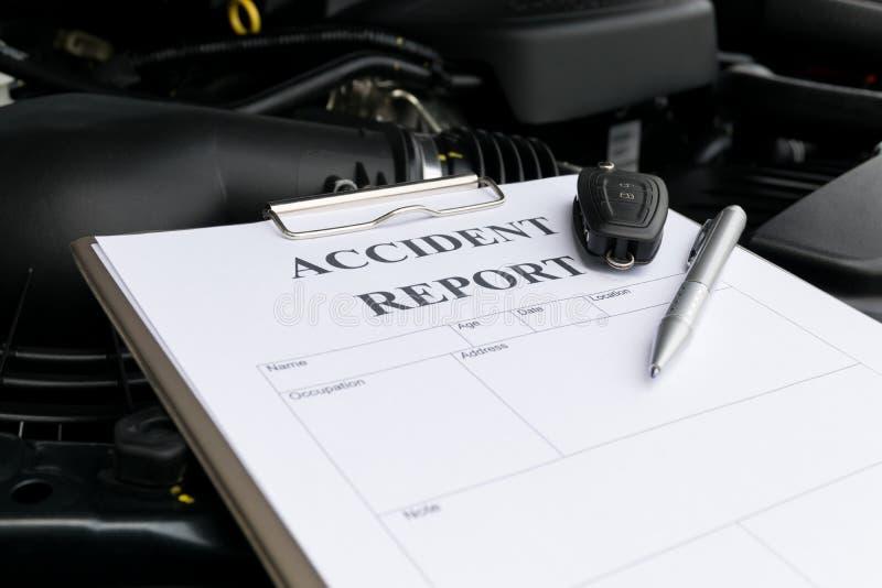 Mechanic Inspecting damage car royalty free stock image