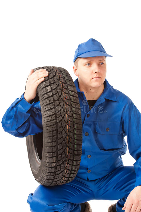 Free Mechanic Is Holding One Car Tire Stock Photo - 22965120