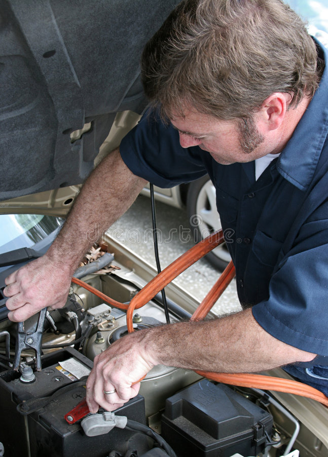 Free Mechanic & Jumper Cables Stock Image - 632471