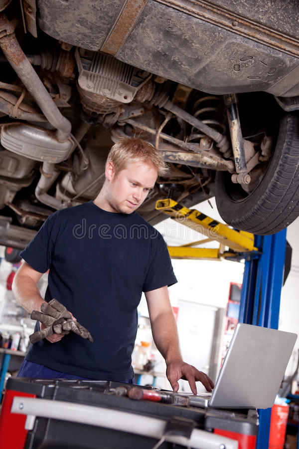 Mechanic with Laptop stock photography