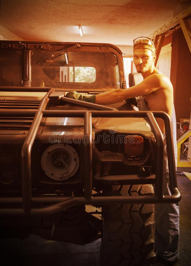 Mechanic makes a new car body big machine royalty free stock image