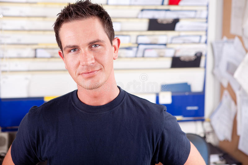 Download Mechanic in Office stock photo. Image of confident, garage - 20875568