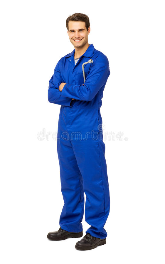 Mechanic In Overalls Holding Wrench. Full length portrait of happy male mechanic in overalls holding wrench over white background. Vertical shot stock image
