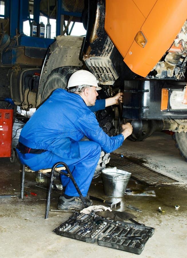 Mechanic repair the truck. Industril area. Mechanic repair the truck royalty free stock photo