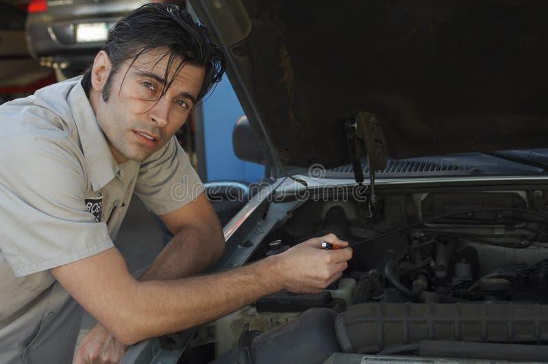 Mechanic Repairing Car Engine royalty free stock photos