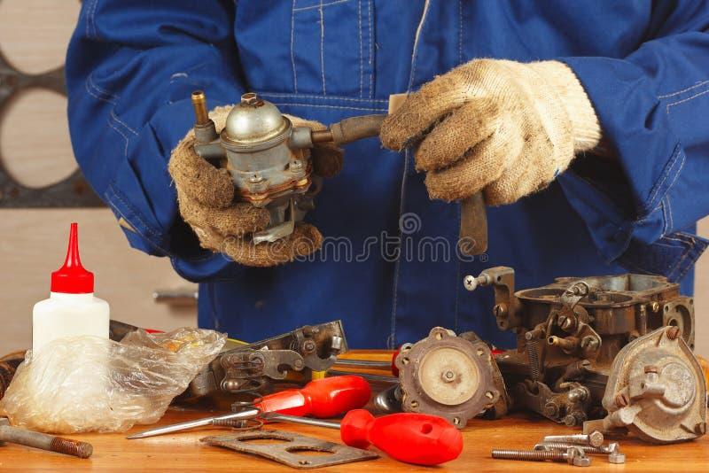 Mechanic repairing old car engine fuel pump stock photos