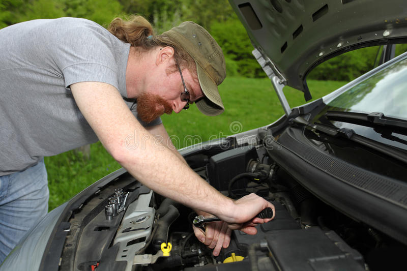 Mechanic repairs a car royalty free stock image