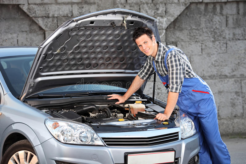 Mechanic searching for a car problem stock photos