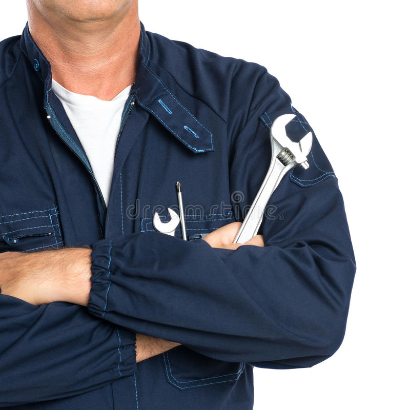 Mechanic With Spanner. Closeup Of A Mechanic With Arm Crossed Holding Spanner Isolated On White Background stock photo