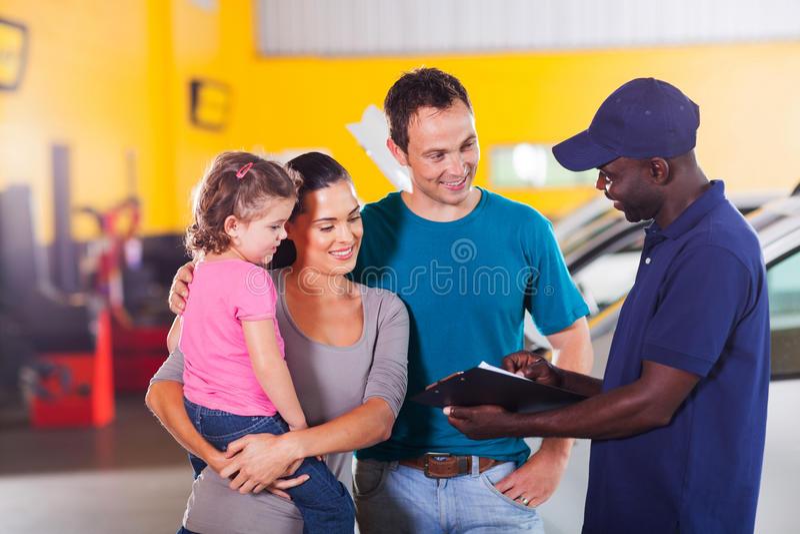 Mechanic talking family stock photography