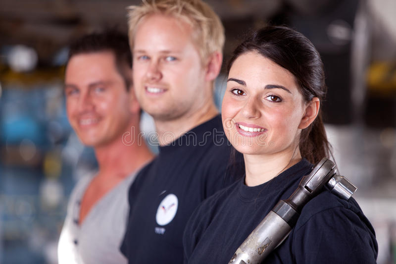 Mechanic Team With Woman Stock Photo