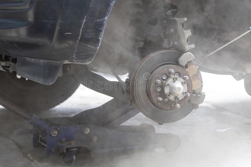 Mechanic use air gun clean disc break take dust removes before change break pat. Transportation concept. Mechanic use air gun clean disc break take dust removes royalty free stock images
