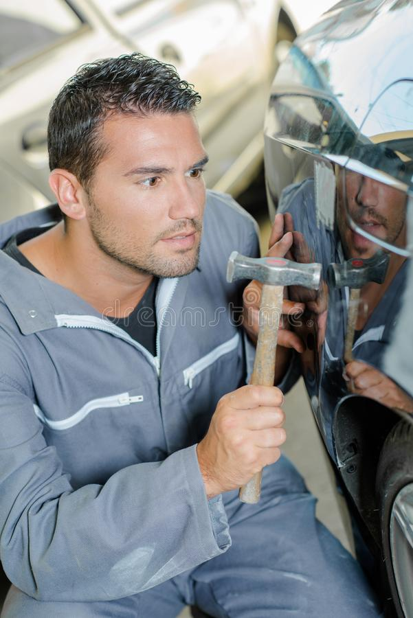 Mechanic using a hammer royalty free stock photos