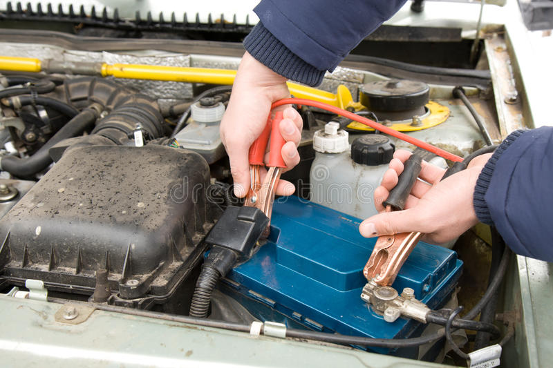 Download A Mechanic Using Jumper Cables Stock Image - Image: 23660337