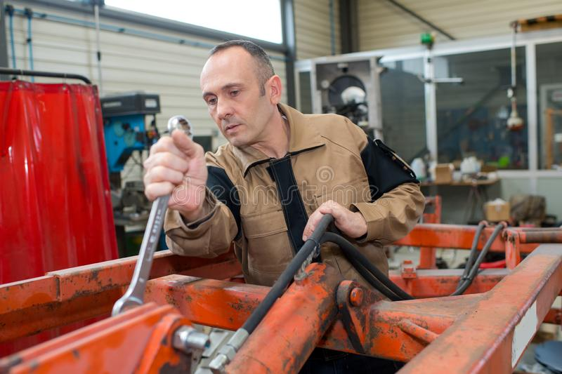 Mechanic using large spanner stock photos