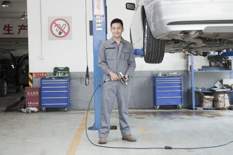 Mechanic Using Power Tool stock photography