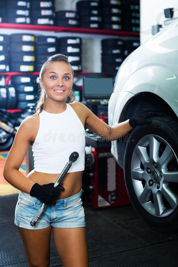 Mechanic working on car whee stock images