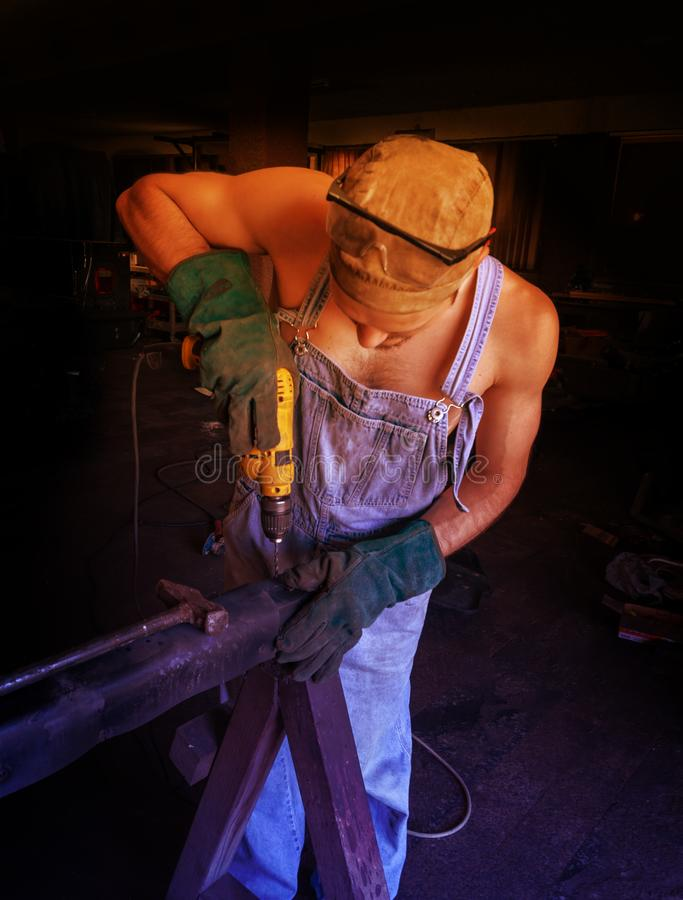 The mechanic works to prepare the parts for the machine royalty free stock image