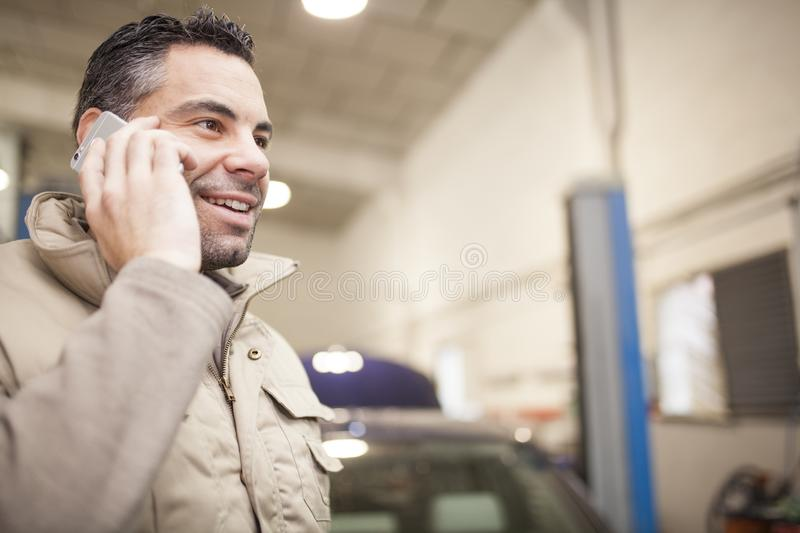 The mechanic works in the workshop stock photography