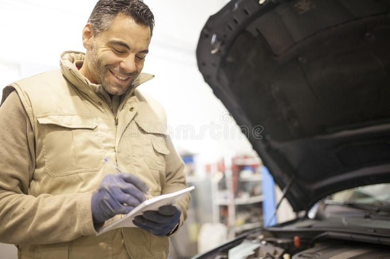 The mechanic works in the workshop royalty free stock image