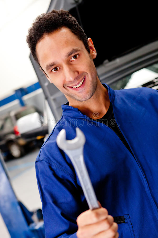Download Mechanic with a wrench stock image. Image of male, repair - 23717319