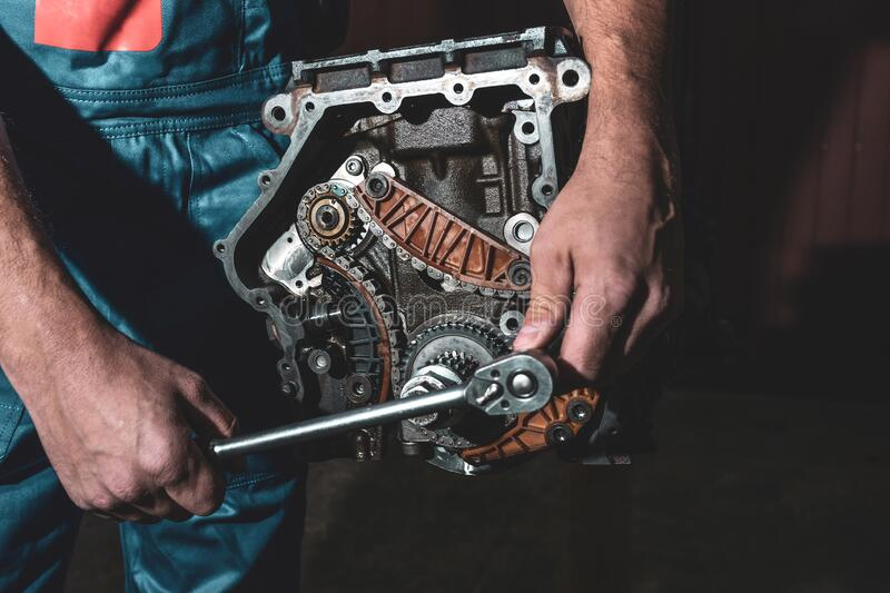 Mechanic with wrench working and repair car engine in car service centre.  royalty free stock photos