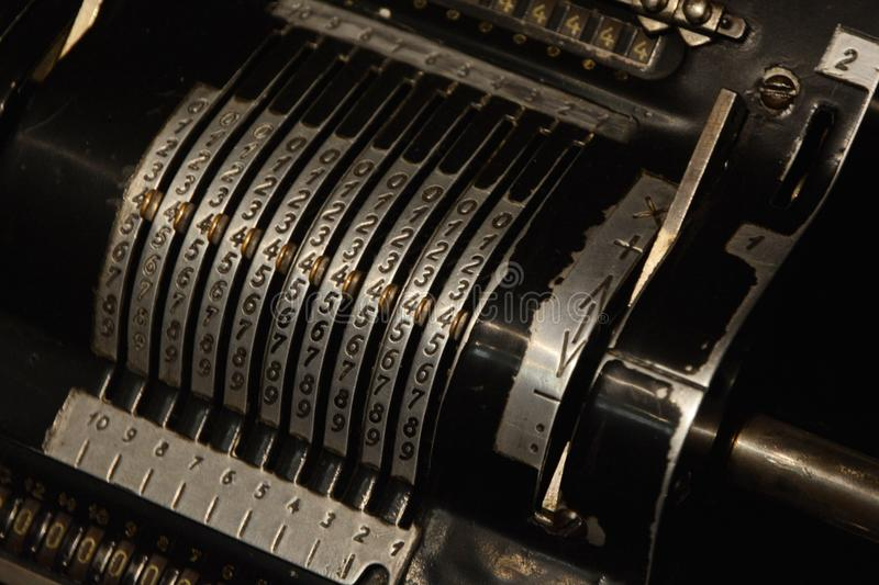 Vintage mechanical calculator calculating counting machine. Detail mechanical calculator calculating machine. Vintage mechanical manual counting machine stock images