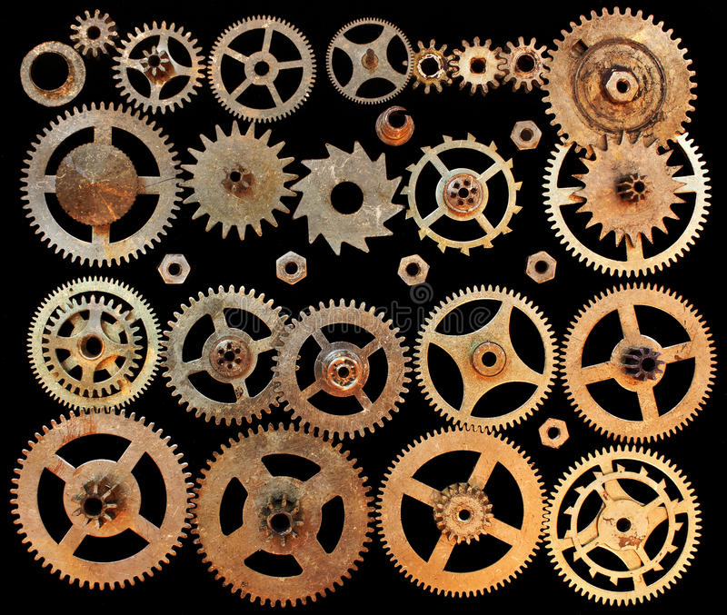 Mechanical cogs gears wheels. Isolated on a black background royalty free stock photos