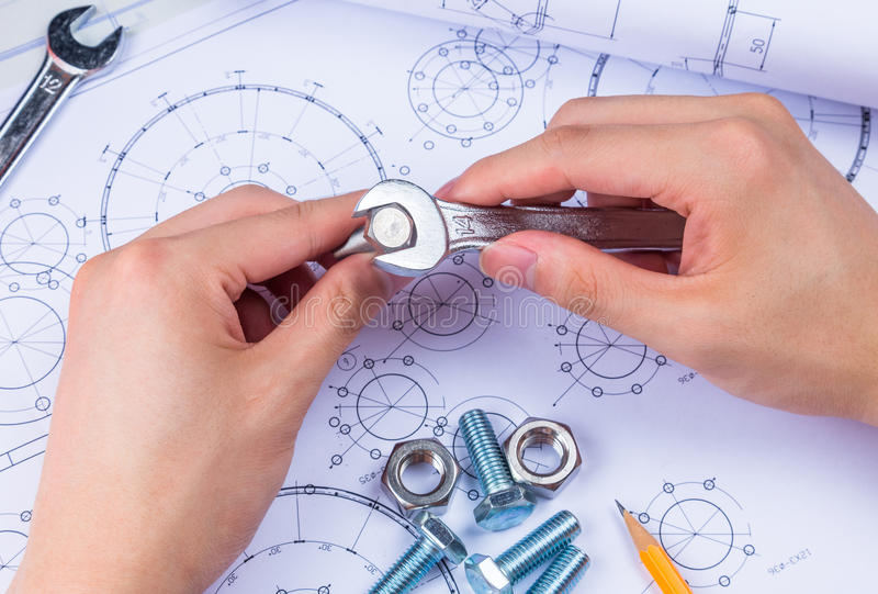 Mechanical Design Engineer in drawing royalty free stock image