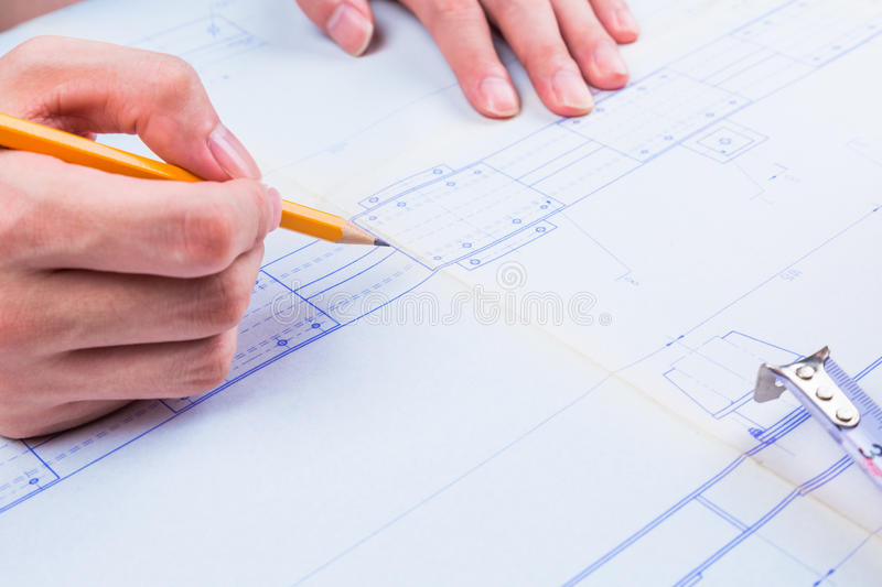Mechanical Design Engineer in drawing royalty free stock images