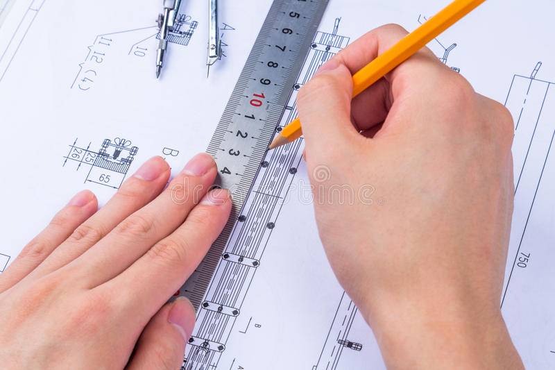 Mechanical Design Engineer in drawing royalty free stock photo
