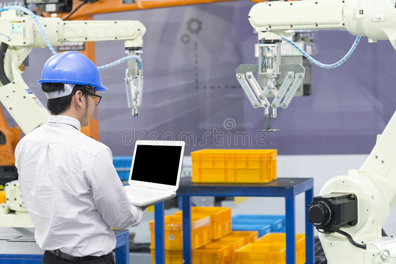 The mechanical engineer control robot arm royalty free stock image