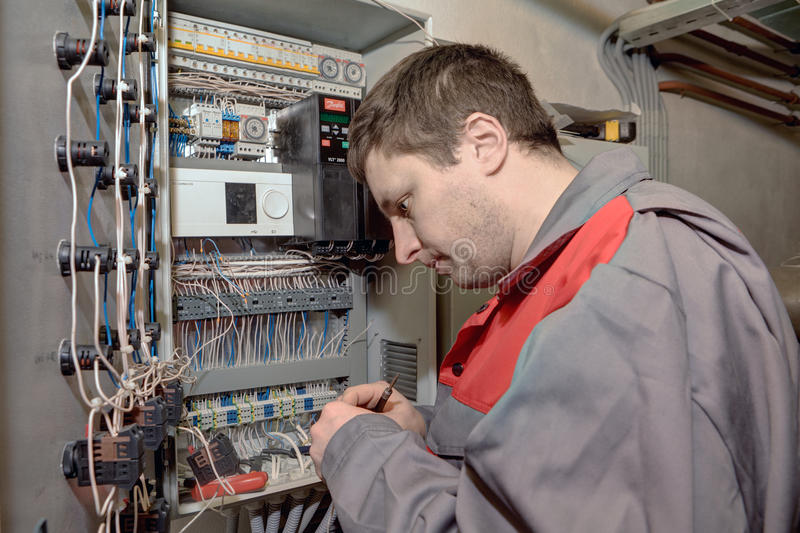 Mechanical Engineer doing upgrade equipment electrical switchboard. royalty free stock photography