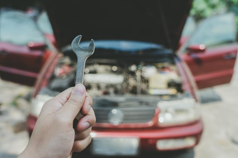 Mechanical engineer hands open the car skirt to check the oil level of the car. The concept of engine maintenance Travel safely royalty free stock photos