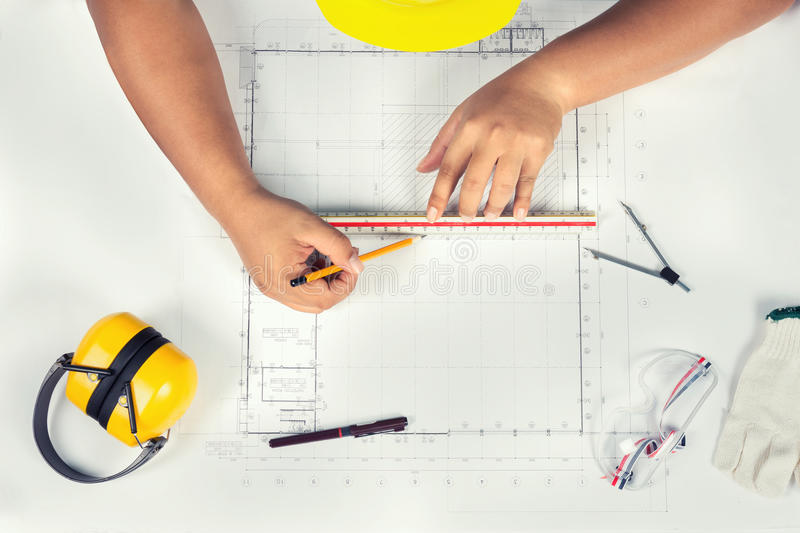 Mechanical engineer at work. Technical drawings. Paper with technical drawings and diagrams royalty free stock photography