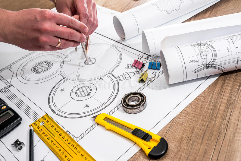 Mechanical engineer with work at technical drawings. And work tools stock photo