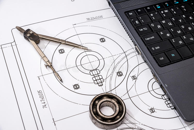 Mechanical engineering of parts with tools, laptop. Drawing top royalty free stock images