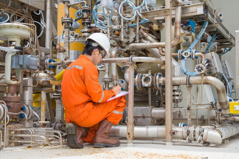 Mechanical inspector inspection on gas turbine compressor to find an abnormal condition. royalty free stock photos