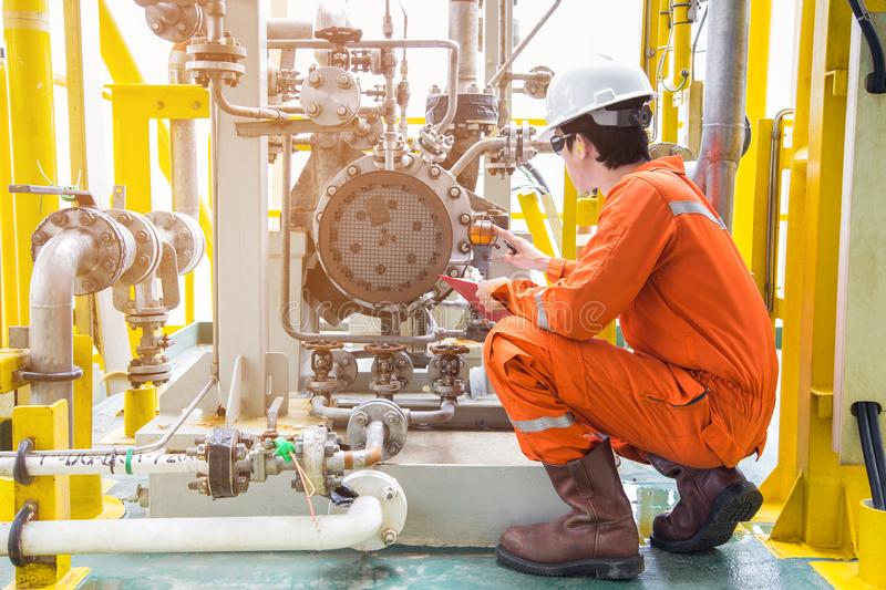 Mechanical inspector inspection oil pump centrifugal type. Offshore oil and gas industry maintenance activities.  royalty free stock image